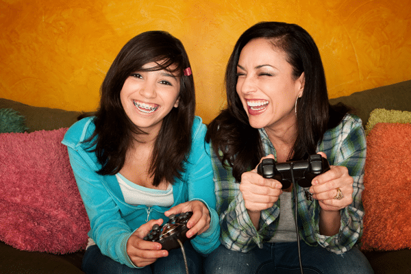 mother-and-daughter-playing-video-games