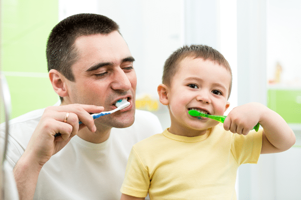 father-and-son-brushing-teeth